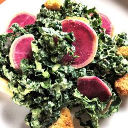lacinato kale with creamy avocado dressing and watermelon radishes