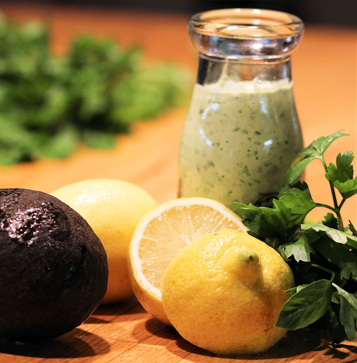 Creamy Avocado Dressing with avocado, lemon, and parsely